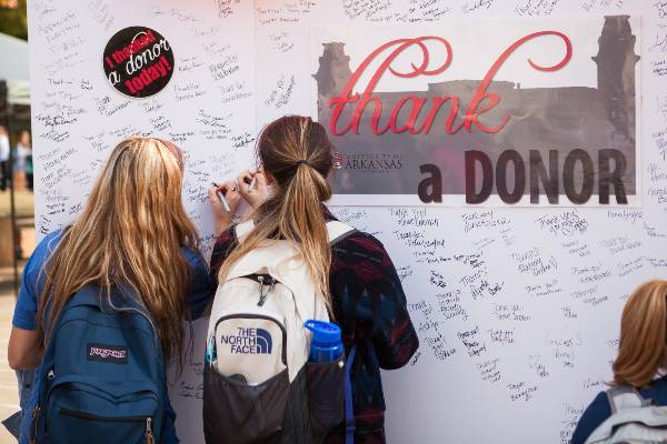 Students signing a giant card on Thank a Donor Day 2014